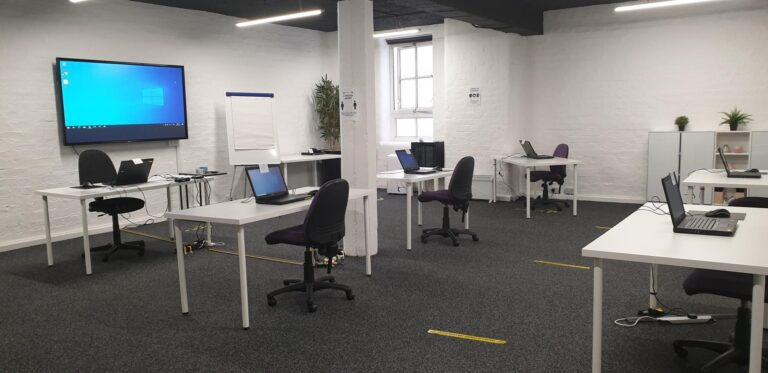 Training Room with laptops spaced 2 metres